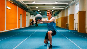 Thomas Roehler with medicine ball